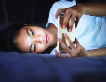 Woman using smartphone to illustrate blue light protection